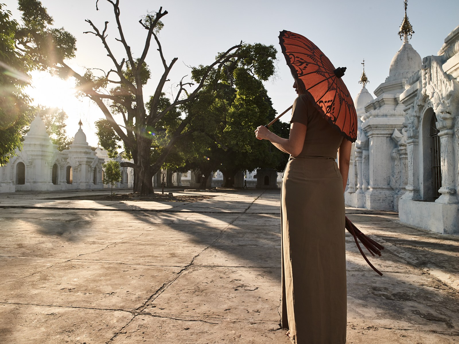 Destination shot in a pagoda in Mandalay Burma, with a model wearing an umbrella